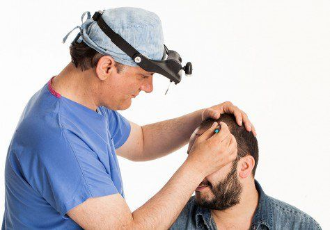 Dr. Yetkin Bayer prepare a BU Clinics client for a FUE Hair transplant procedure