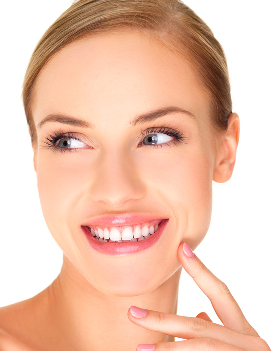 A beautiful woman smiles after her Hollywood smile treatment